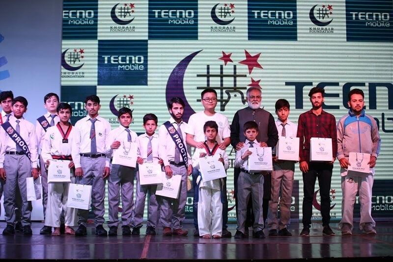 Group Photo of Tecno CEO and Khubaib Chairman with Prphans
